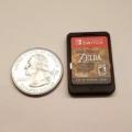 닌텐도 스위치 게임 카드 실물 유출... 동전 만한 크기